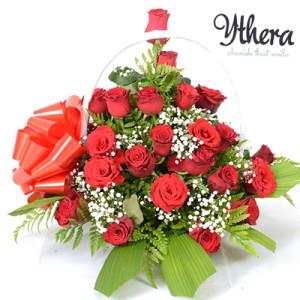 A lovely flower basket of red roses